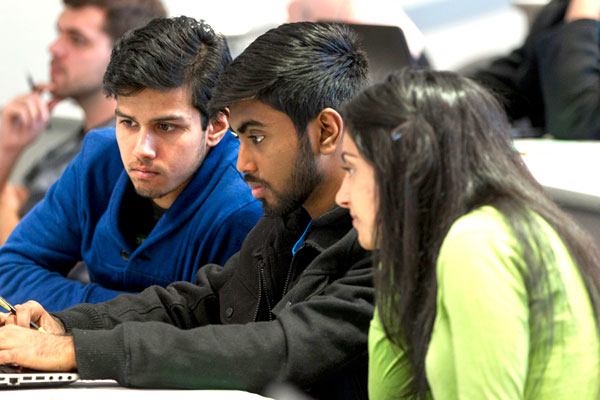UT Dallas business school students studying together at the Jindal School of Management