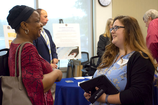 Master's in Accounting student meeting with a recruiter at an employer event