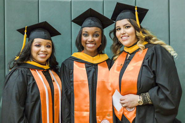 Stefanie Johnson, Elizabeth Henderson and Maria Dominguez graduated with master's degrees in healthcare management.
