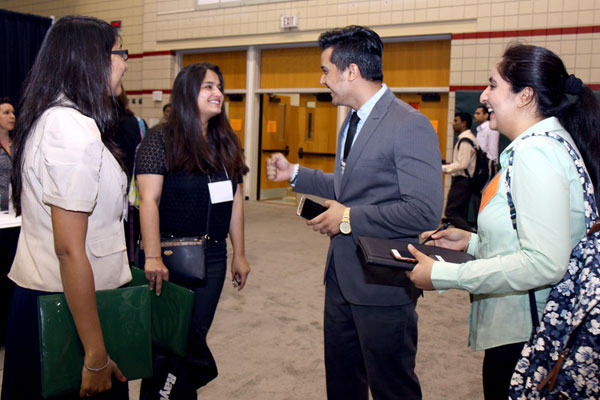ut dallas undergraduate students talking at a career fair