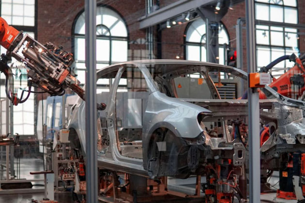 Car being assembled at a factory