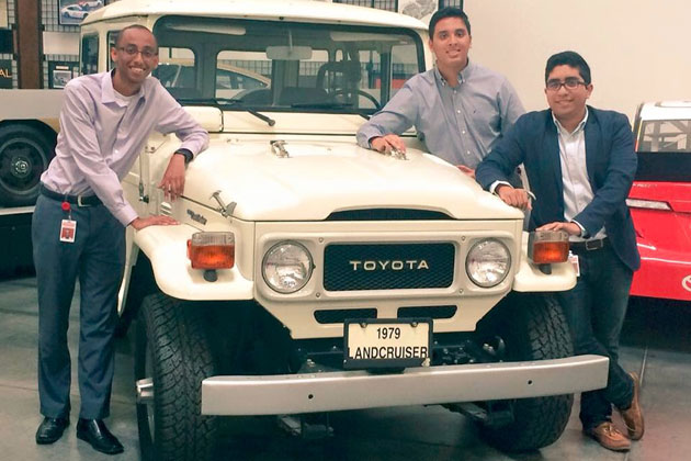 supply chain students posing with a toyota