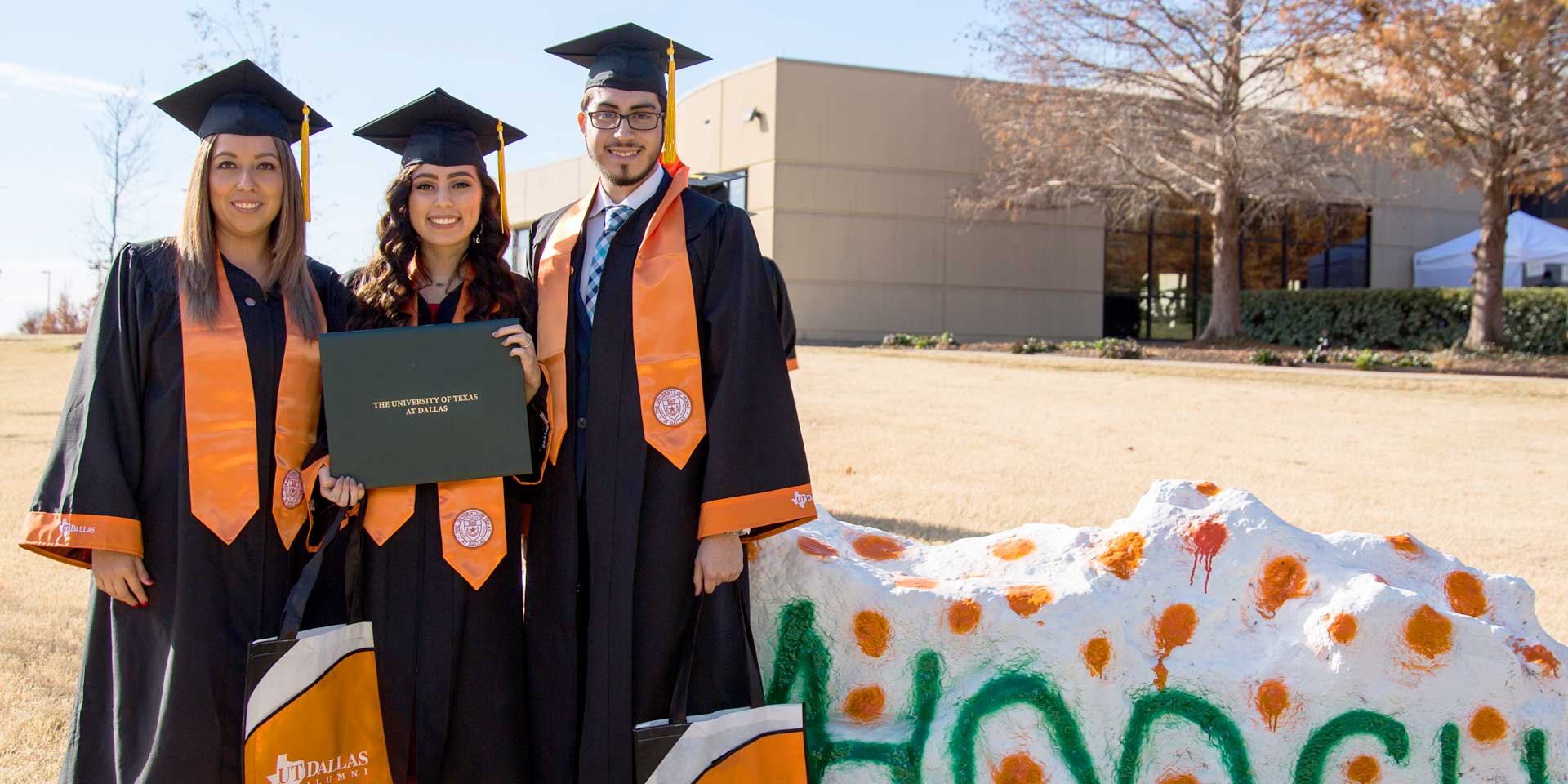 Bachelor's in supply chain management graduate Alfredo Beltran with two friends who graduated with bachelor's degrees at the Jindal School, UT Dallas