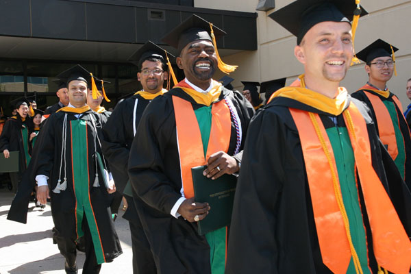 Master of science in management science graduates in cap and gown
