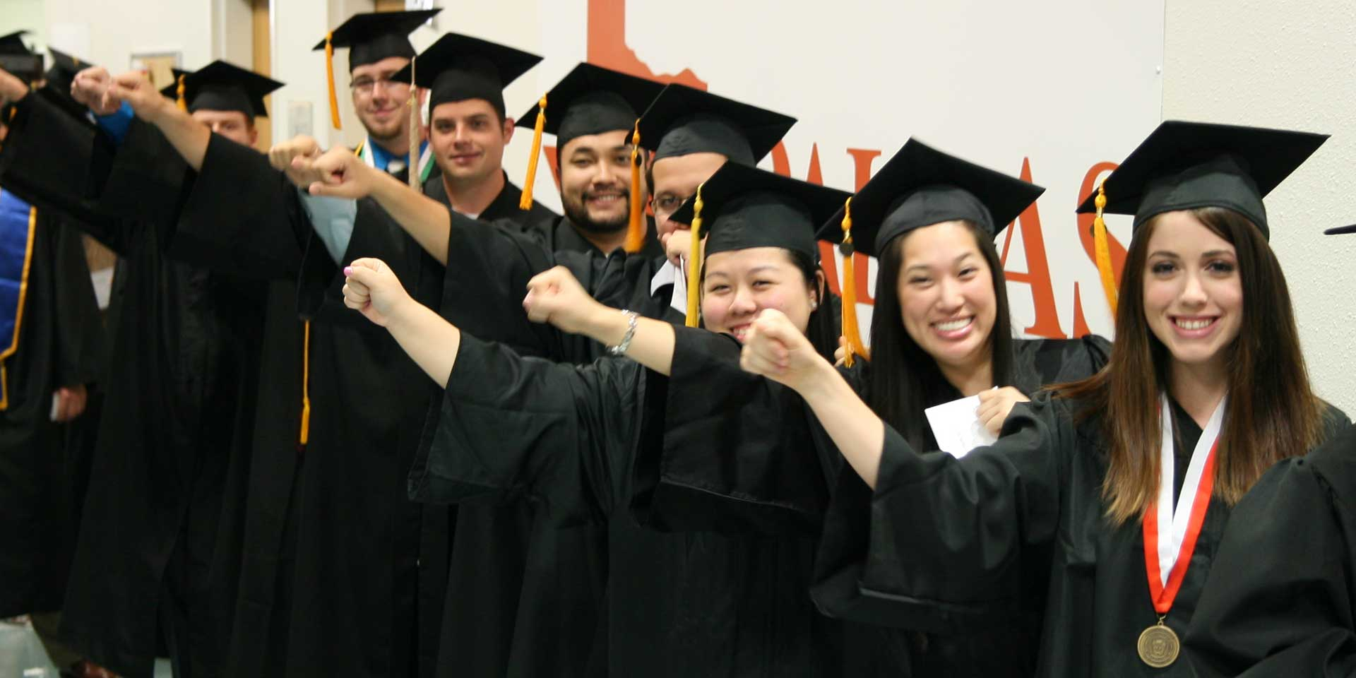 Jindal School students lined up on UT Dallas commencement day, getting ready to graduate with their degrees, including Master's in Management Science
